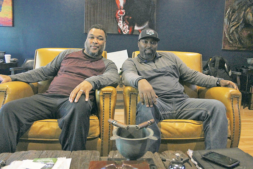ABU AND CHUCK SWAFFORD, respectively, are two cousins who serve as co-owners of the all-new Ocoee Cigars lounge off Ocoee Street. Both having an interest in cigars, the two believe they filled a niche market by opening their new storefront.