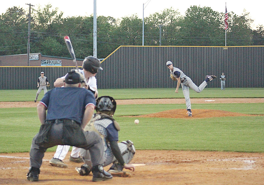 MUSTANGS STARTING PITCHER Jake Smith throws to the plate against McMinn County Monday, in Athens.