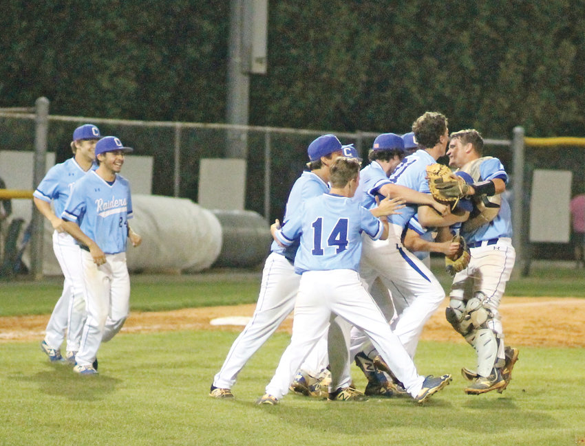 CLEVELAND TEAMMATES swarm senior ace Patrick Williams, second from right, after the Lipscomb signee struck out 15 to lead the Blue Raiders to a 4-1 upset of district regular season champ Bradley central Monday evening at the Toby McKenzie Baseball Complex.