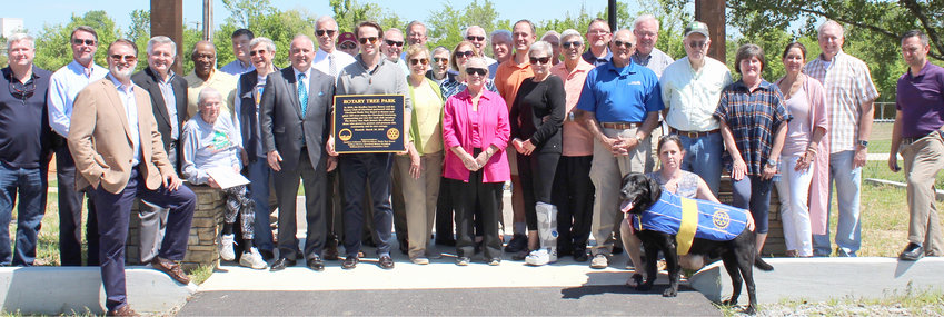 "CLEVELAND CELEBRATED Arbor Day on Tuesday, with a ceremony at Tinsley Park. Shown are members of the Rotary Club of Cleveland, Bradley Sunrise Rotary Club, Cleveland's Shade Tree Board, Cleveland Mayor Kevin Brooks, Mayor Emeritus Tom Rowland, and members of the Cleveland City Council, among others. A temporary version of a sign depicting ""Rotary Tree Park"" was also presented."