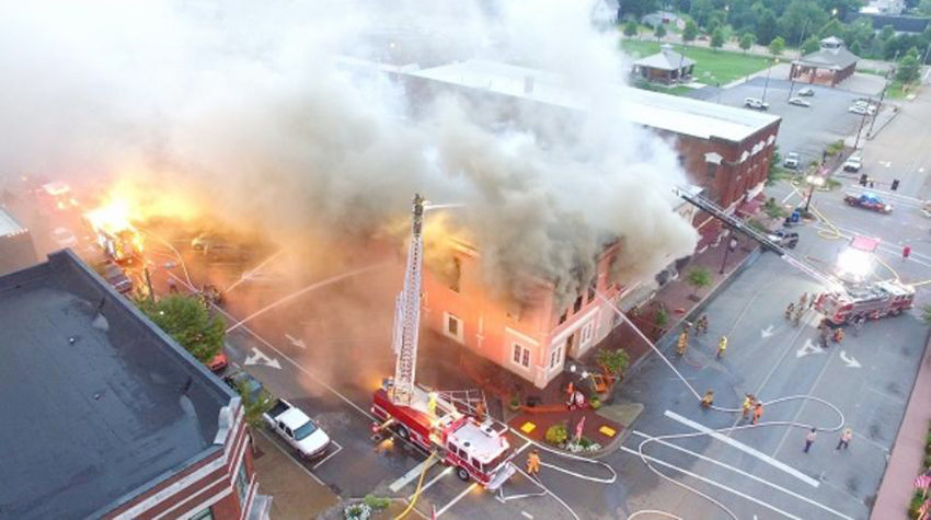 Contributed file photo  THIS July 1, 2017, photo shows the fire that devastated the Athens Area Chamber of Commerce. The restoration has been completed and the chamber has now returned to its building. It took 16 fire departments all day to completely extinguish the fire.