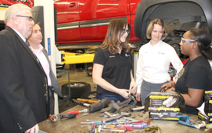 CLEVELAND HIGH automotive student Destiny Duncan, right, talks with a group of visitors at the school earlier this week. They included, from left, Cleveland Schools CTE Supervisor Renny Whittenbarger, Assistant Director of Schools Dr. Jeff Elliott, Amanda Plecas of Volkswagen Chattanooga, and VW training specialist Steffi Wegner.