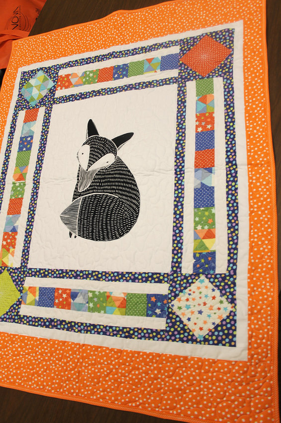 QUILTS SUCH AS THIS are made by members of the talented Cherokee Blossom Quilt Guild in Cleveland, who focus more on learning new skills, honoring their history and veterans and teaching the younger generations than focusing on individual quilters.