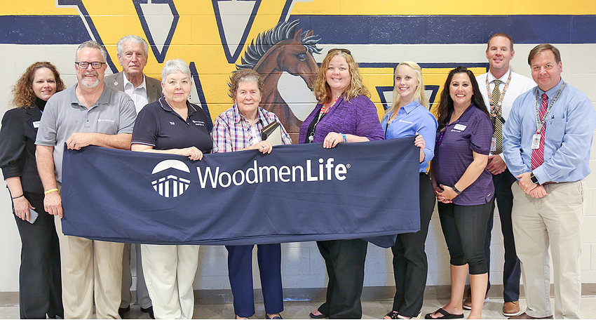 WOODMEN LIFE PROVIDED a barbecue lunch for the teachers at Walker Valley High School on Wednesday for Teacher Appreciation Week. From left are Cheryl Bressler, Chuck Haggart, W.W. Johnson, Eula Kile, Joyce Johnson,  Amy Kier, Rose Jaggers, Courtney Witherow, Denny Collins and David Hood.