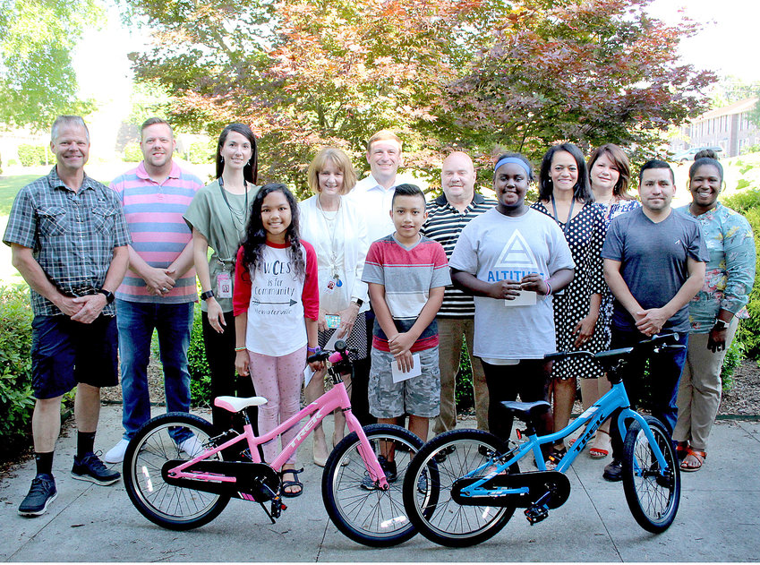 STUDENTS being honored for perfect attendance by the Cleveland Masonic Lodge and Scott's Bicycle Centre are, from left, Hicari Karaseran, Yenri Mazarigos and Jordin Bradford. Joining them are Scott's Bicycle Centre owner Doug Coulter, Cleveland Masonic Lodge leader Randy Sharp, Waterville Community Elementary Principal Dr. Heather Hayes, Bradley County Schools Director Dr. Linda Cash, Cleveland City Schools Director Dr. Russell Dyer, Cleveland Masonic Lodge member Barry Phillips, Blythe-Bower Elementary Principal Prisavia Croft, George R. Stuart Elementary Principal Richelle Shelton and Evider Mazarigos and Kim Bradford, parents of two of the students. Not pictured is a fourth student winner, Michael Jacinto-Augustin, who was busy with a school activity.
