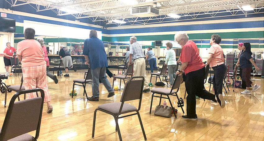 THE SILVER SNEAKERS class at the Cleveland Family YMCA works out along with instructor Betty Mason. This is one of various other classes for seniors offered at the Y.