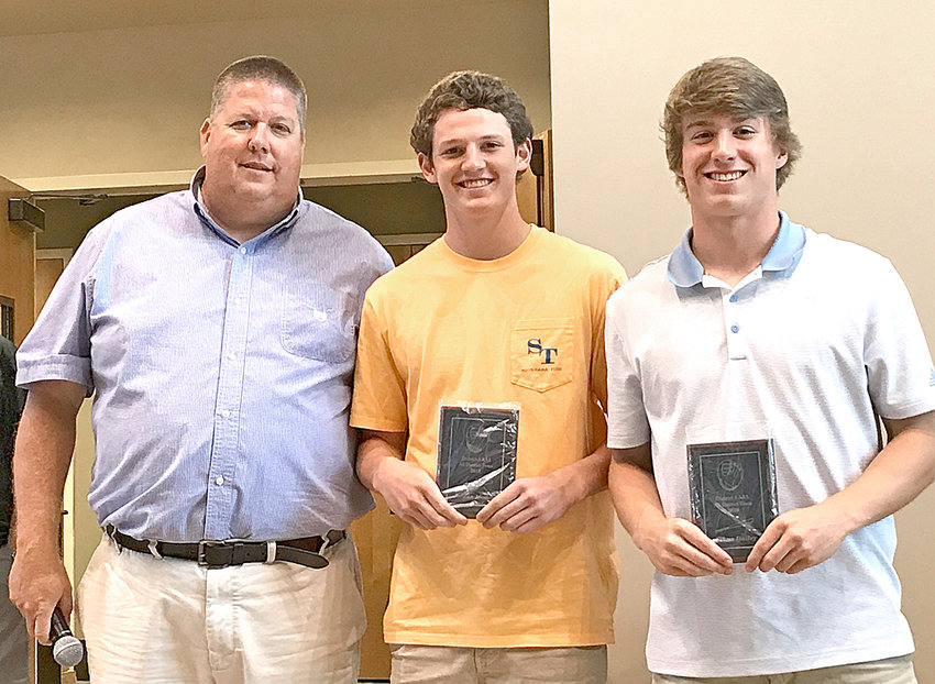 WALKER VALLEY MUSTANGS Jordan Munch, center, and Ethan Hailey, right, pose with their All-District plaques at the 2019 WVHS baseball banquet. At left is Mustangs head coach Joe Shamblin.