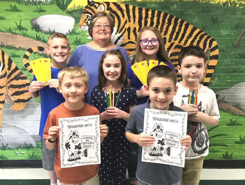 Pictured from left with Carolyn Earnest, women's chair, are the fifth-, third- and second-graders from Taylor. Front row are Silas Ellis and Bentlee Richesin from Mrs. Avdyukov's second grade. Middle row are Haven Thompson and Charlie Sweet from Mrs. Price's third grade. Back row are Landon Bunch and Kambria Charles from Mrs. Snider's fifth grade. Second grade students received an agricultural coloring book. Third grade students received pencils and fifth grade students received book marks.