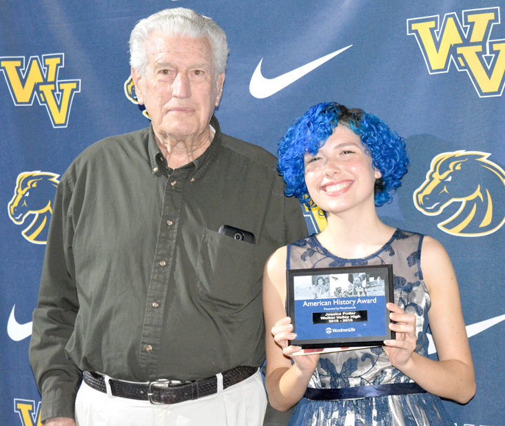 WOODMEN LIFE MEMBER W.W. Johnson, left, presented Walker Valley High School student Jessica Potter with the 2019 Woodmen Life History Award and Scholarship at the WVHS Senior Night.