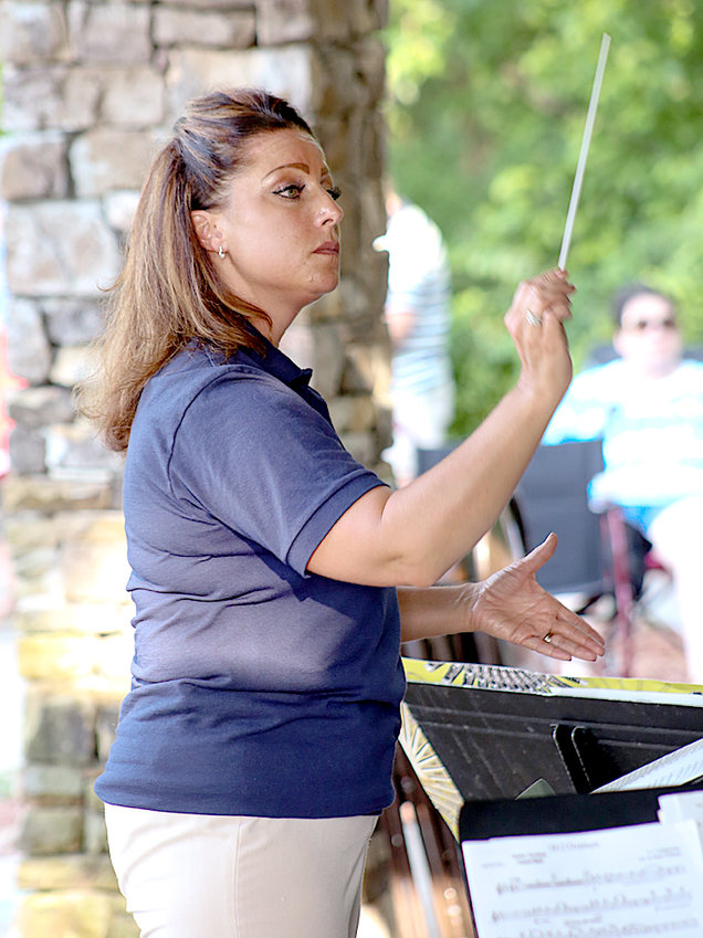 """CLEVELAND POPS DIRECTOR Sarah Pierson leads the orchestra through """"An American Celebration"""" on Monday night."""