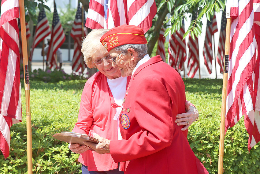LIZ NORWOOD, wife of the late Bill Norwood, left, congratulates Marilyn Nagel for being named the 2019 Bill Norwood Service to Veterans Award recipient at Monday's event.