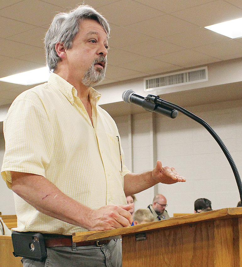 DR. JOHN STANBERY spoke against raising taxes during Tuesday night's Bradley County Commission work session.