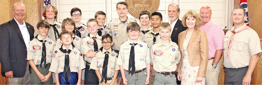 """BOY SCOUT TROOP 44 attended Tuesday's Bradley County Commission meeting as part of the requirement to earn the """"Citizenship in the Community"""" merit badge. From left, adults shown with the Scouts are Sheriff Steve Lawson, County Mayor D. Gary Davis, Director of Schools Dr. Linda Cash, and County Commission Chairman Johnny Mull."""