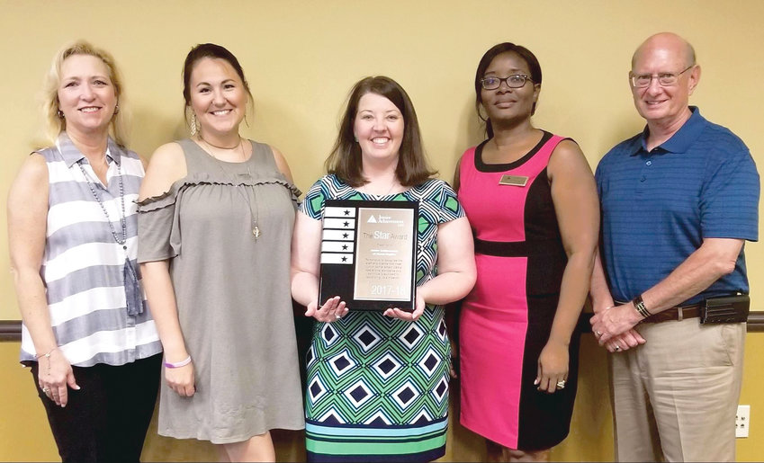 JUNIOR ACHIEVEMENT of the Ocoee Region has received the national organization's 5 Star Award for the second year in a row. From left are Melissa Gunnell, JA executive assistant; Bethany McCoy of Lee University, JA board chairman 2017-2018; Jennifer Pennell-Aslinger, JA president; Liz Mathurin, JA programs manager; and Ken Jones of LPL Financial, JA board chairman 2018-2019.