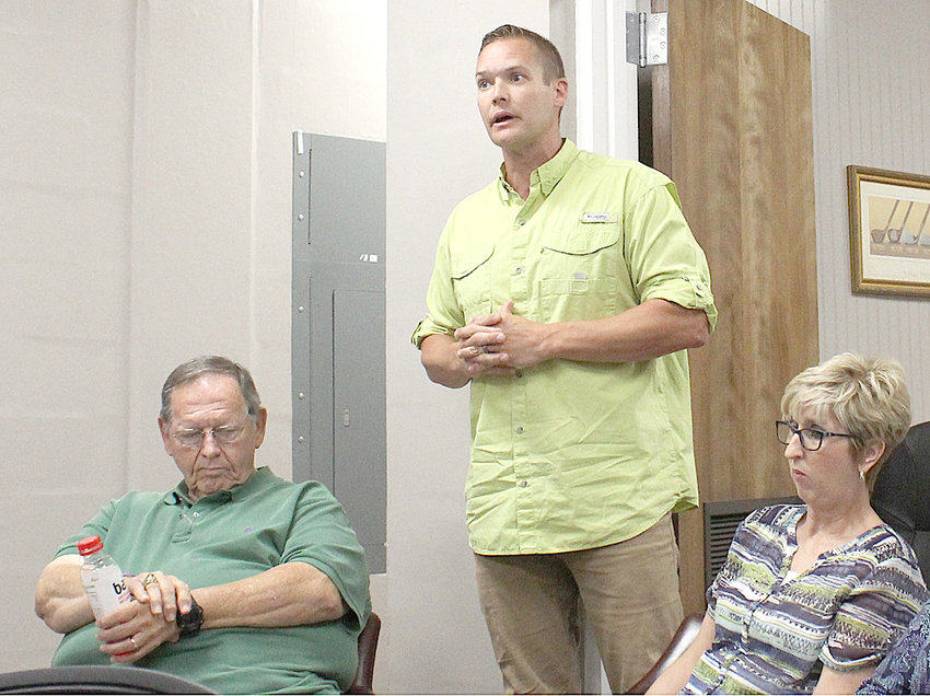 KYLE PAGE, site director for the PIE Center, spoke to the Bradley County Commission's Finance Committee Monday, responding to questions posed by two former commissioners. Also shown are Bradley County Board of Education Vice Chairman Jerry Frazier and Susan Willcut, the school system's finance director.