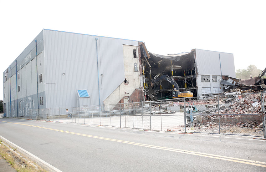 A HEAVY EQUIPMENT operator rips through the floors of the old Whirlpool Plant 2 on Tuesday.