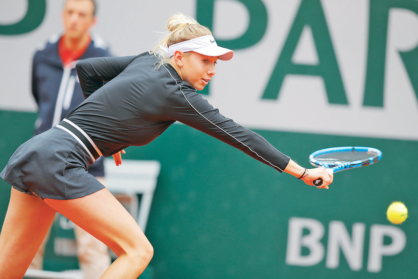 AMANDA ANISIMOVA plays a shot against Ashleigh Barty during their semifinal match of the French Open at Roland Garros stadium Friday, in Paris.