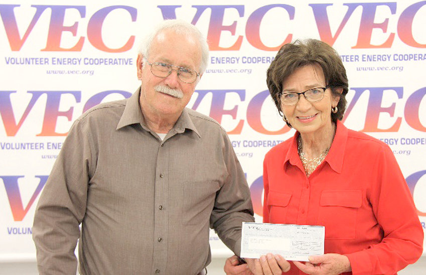 VECustomers Share Board Member Dana Burgner presented a grant check to Karen Cross from New Life Community Kitchen. Grant funds will provide a hot lunch five days a week and will also provide food bags that do not require refrigeration or cooking for the homeless and street people.