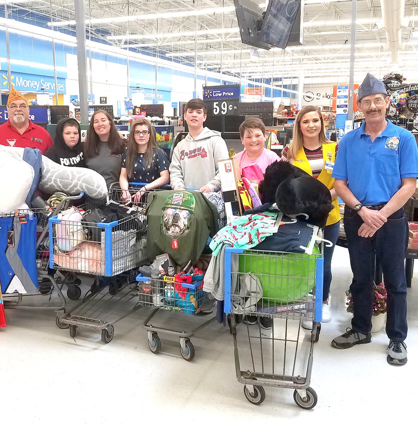 THE NATIONAL VETERANS Association 40&8 recently stepped up to help a local family in need. The 40&8 purchased essential items for the Davis/Wooten family that suffered a total loss of their home, and contents, due to a fire. This veteran agency assists community members, especially veterans, in dire times of need. At the presentation at the Walmart store were, from left, Chef de Chemin de Fer, national commander, 40 & 8; Rick Williams; family members Jacob, Stephanie, Halea, Riley and Nathaniel; Walmart Customer Service Manager Emily Bishop; and 40&8 veteran Daniel Koob.