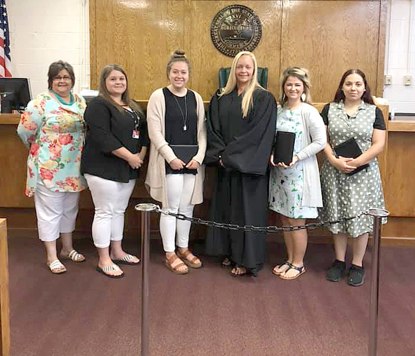 From left are Connie Lucas, Case and Volunteer Manager Natalie Barrionuevo, Alexys Jones, Judge Ashley Gaither, Carolanne Crisp and Eliana Tarver.