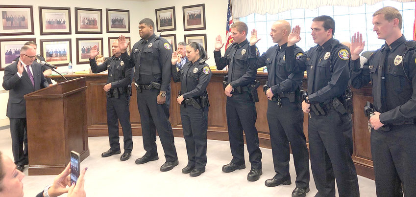 SEVEN new Cleveland Police Department officers were sworn in by Cleveland Mayor Kevin Brooks during the Cleveland City Council's work session held Monday at the Municipal Building. Picture from left are Mayor Brooks, Brandon Lee, Kory Gillam, Misha Fanelli, Zachary Kilby, Jonathan Higdon, Evan Driskill and Aaron Harding.