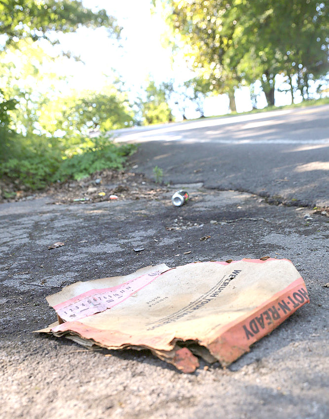 WHETHER IT'S found in a big pile on public a right of way or on private property, or carelessly strewn about in scant amounts such as here on the road shoulder of 37th Street, litter is litter. Although several community programs are working to control it, it's still a case of Tennessee trash making its way into Cleveland and Bradley County.