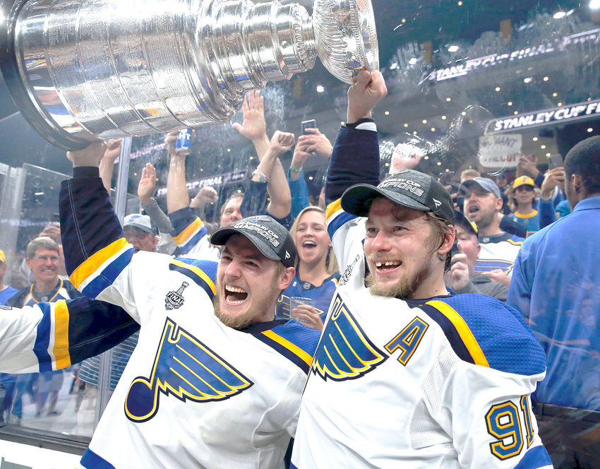 ST. LOUIS BLUES Ivan Barbashev, left, and Vladimir Tarasenko hold the Stanley Cup after the Blues defeated the Boston Bruins in Game 7 of the Stanley Cup Final Wednesday, in Boston.