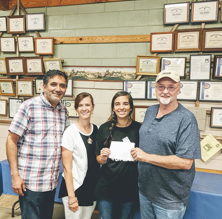 One of many projects the McDonald/Black Fox Ruritan Club undertakes each year is the choosing of recipients to receive a scholarship to the college of their choice. This year's first of four recipients was Miraina Patel, who will be attending Chattanooga State Community College.  From left are her parents Raj and Michelle Patel, Miraina, and Ruritan President David Swafford.