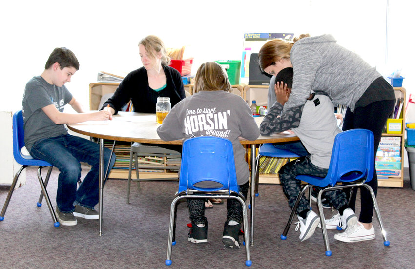TEACHERS at the Lee University Developmental Inclusion Classroom, or LUDIC, work with a small group of students in this file photo from 2017. Parents were recently informed this private school for autistic students soon expected to close.