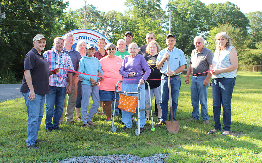 SUPPORTERS of the McDonald Community Center, including members of the McDonald Blackfox Ruritan Club, community center neighbors and the Bradley County Commission, met Thursday to break ground for a walking trail. Cutting the ribbon was Inez Doty, who was a student at McDonald School and is believed to be the oldest member of the McDonald Black Fox Ruritan Club.