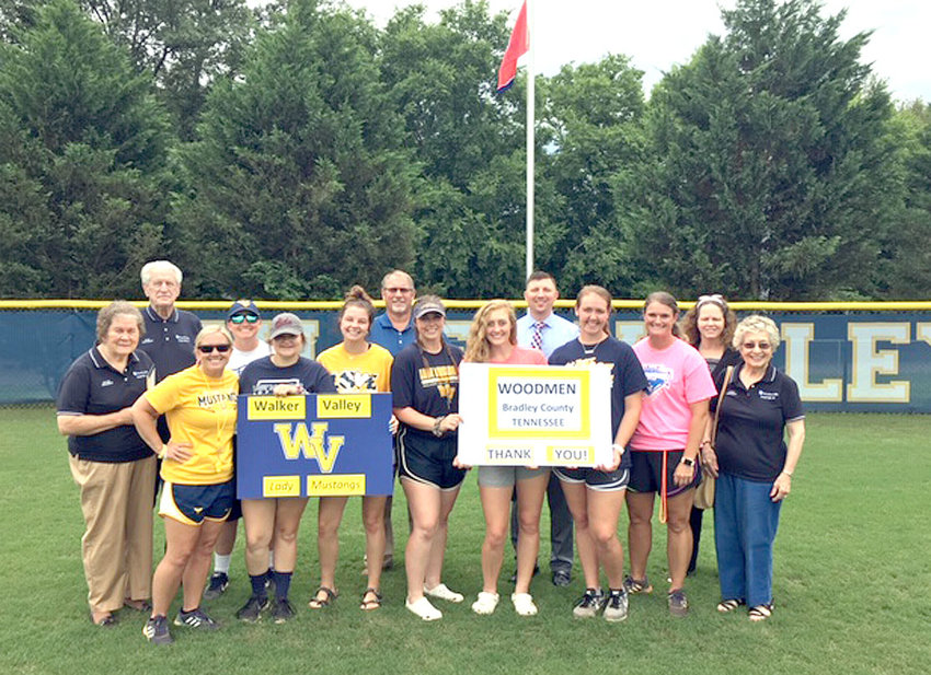 On hand for the dedication on a new flag pole at WVHS Larry Haney Softball Field were, from left, Joyce Johnson, Woodman; coaches Lauren Limburg and Rachel Percy; seniors Bailey Smith, Sydney Everett, Hannah Kate Singleton, Riley Suits and Kaylea Hughes; coach April Richards; Linda Johnson, Woodmen; and back, W.W. Johnson, Woodmen; David Brown, East Tennessee Community Outreach leader; Adam Lowe, regional director; and Cheryl Bressler, Woodmen representative. Not available for photo was Abbey Davis.