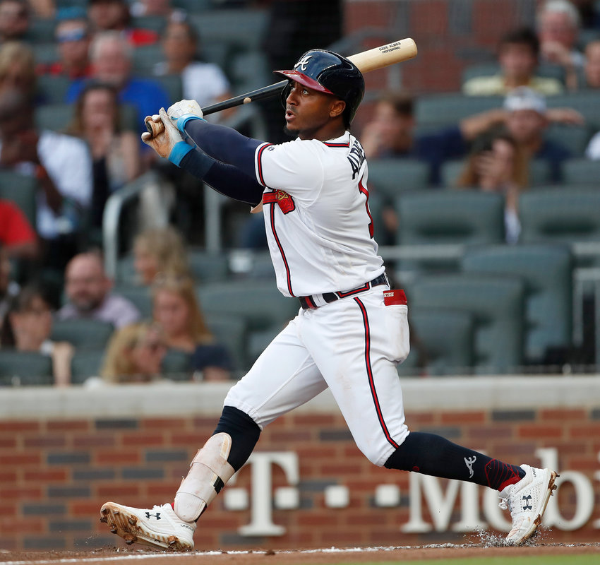 Atlanta Braves second baseman Ozzie Albies (1) bats against the New York Mets during in a baseball game Monday, June 17, 2019, in Atlanta. (AP Photo/John Bazemore)