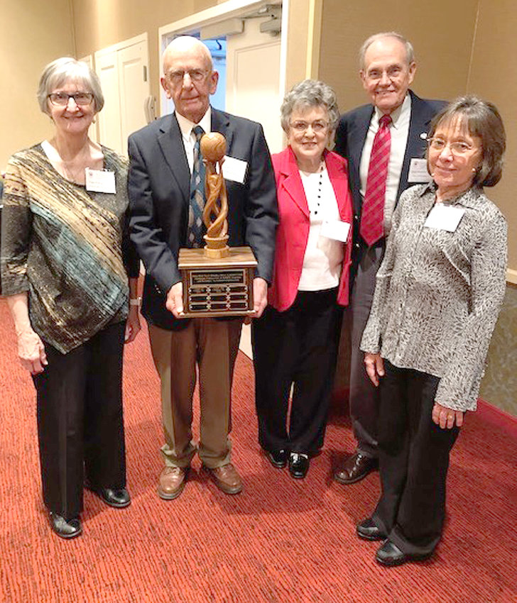 MEMBERS OF CLEVELAND's chapter of retired and active federal employees are shown at a recent state meeting with the annual Weida White Tolley Memorial Award, which is presented to the state chapter that leads in fundraising for Alzheimer's research each year. The Cleveland Chapter has won the award four of the past five years. Receiving the award were, from left, chapter member Peggy Walkup, Chapter President Danny Britt, Bertha McAlister, Membership-PR Chairman Dean McAlister, and Treasurer Annabel Webb.