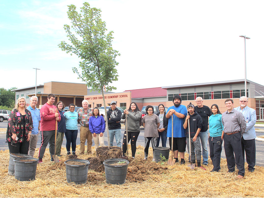 CHEROKEE STUDENTS visiting from Oklahoma toured the new Candy's Creek Cherokee Elementary School and planted a tree on school property. They are joined by staff of Cleveland City Schools and the Cherokee National Forest, which is hosting the students for the month of June.