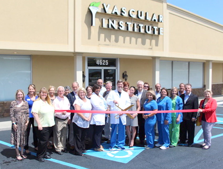 THE VASCULAR INSTITUTE of Chattanooga has opened a new office in Cleveland. The local clinic will treat customers from throughout the Ocoee Region. The new location is at 4625 Lee Highway, and staff members and visitors are shown at the recent ribbon-cutting.
