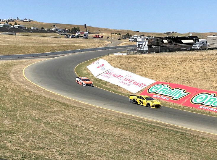 "NASCAR DRIVERS Daniel Hemric (8) and William Byron (24) drive into ""The Carousel"" at Sonoma Raceway during practice Friday, in Sonoma, Calif."