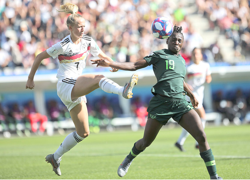 GERMAN'S LEAS SCHUELLER, left, battles with Nigeria's Chinwendu Ihezuo during the Women's World Cup round of 16 soccer match between Germany and Nigeria at Stade del Alpes Saturday, in Grenoble, France.