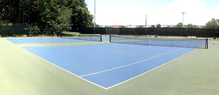 SHOWN ABOVE are two of the seven tennis courts and the sparkling new Tinsley Park facility. The surface of the courts is the the same type used at the U.S. Open.