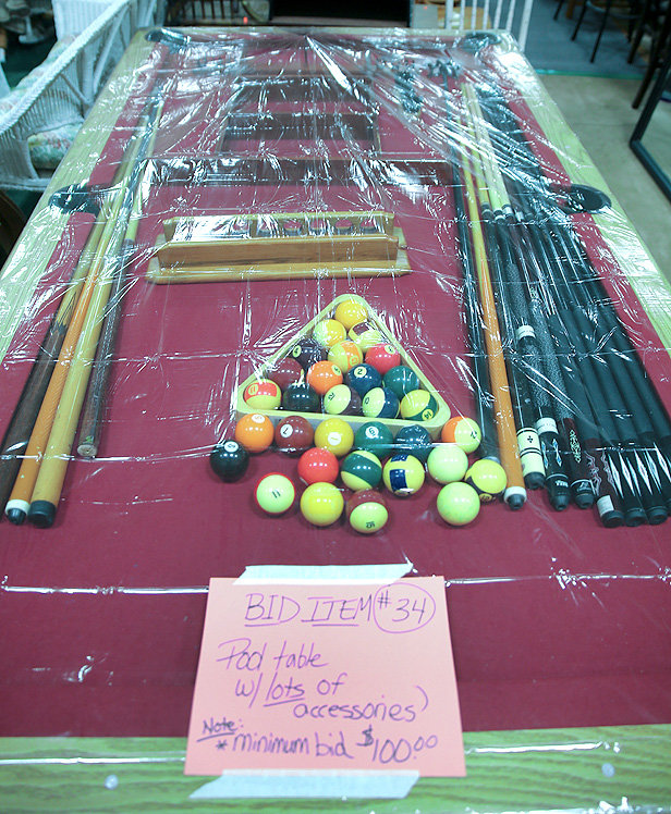 A BILLIARD TABLE, with several pool cues and accessories, is one of the items up for bid at the Bowman Hills School Rummage Sale from Wednesday through Friday.