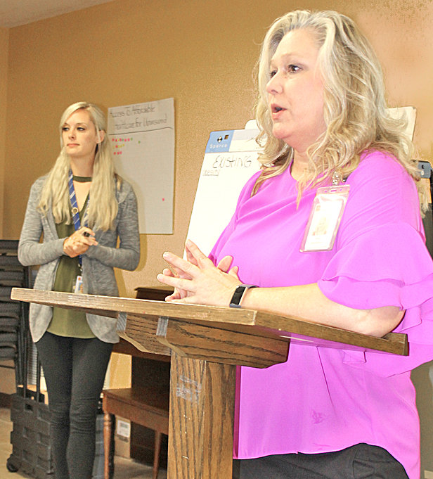 AMY DAVENPORT, right, health educator at the Bradley County Health Department, took suggestions from members of the Bradley County Health Council on organizations in the area designed to tackle the county's top three health-related issues. These included adult obesity, non-fatal drug overdoses and access to healthcare for the uninsured. Rachel Endo, health department public health educator, left, wrote down the information for members to see.