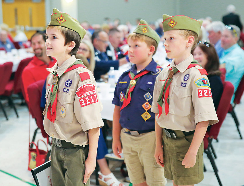 CUB SCOUTS from Pack 3217 presented the colors at Tuesday's annual Veterans Appreciation luncheon at Westwood Baptist. The lofty flagpoles and flags almost overwhelmed the young scouts, but they were up to the challenge.