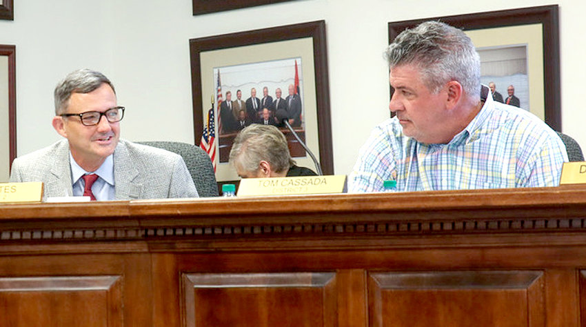 """COUNCILMAN Bill Estes, left, lauds the achievements of Cleveland Vice Mayor Avery Johnson shortly after a vote took place to name a new city park after the veteran councilman. Estes said the Council chose """"to honor someone in the community who reveals our character, who reveals what we value and who reveals what we esteem."""""""