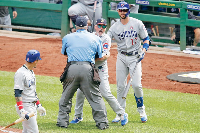CHICAGO CUBS MANAGER Joe Maddon, center, yells toward the Pittsburgh Pirates dugout as he is restrained by umpire Joe West and Cubs' Kris Bryant (17) during the fourth inning in Pittsburgh.