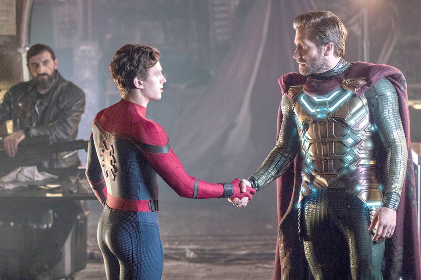 """This image released by Sony Pictures shows, from left, Numan Acar, Tom Holland and Jacky Gyllenhaal in a scene from """"Spider-Man: Far From Home."""""""