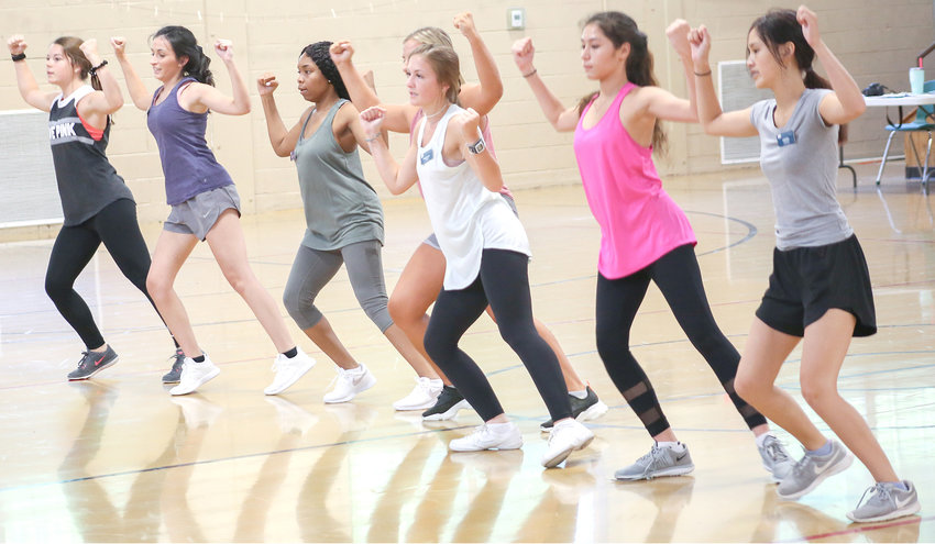 ONE OF THREE groups of DYW contestants practices the fitness routine portion of the program on Tuesday in the Arnold Memorial School gymnasium.