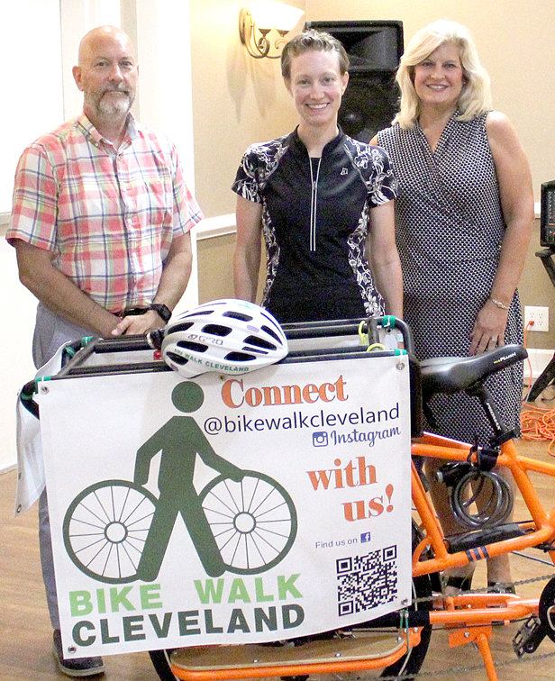 GINA SIMPSON, center, chairman of Bike Walk Cleveland, spoke during a MainStreet Cleveland luncheon held Monday at Elks Club No. 1944. Also pictured are Cleveland MainStreet President Jim Metzger and Cleveland MainStreet Executive Director Sharon Marr.