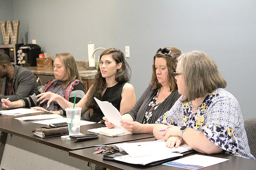 "EMMA BEERS, coordinated entry specialist for the Chattanooga Regional Homeless Coalition, explains the ""Housing First"" concept during a recent meeting of Cleveland's new Housing First Committee."
