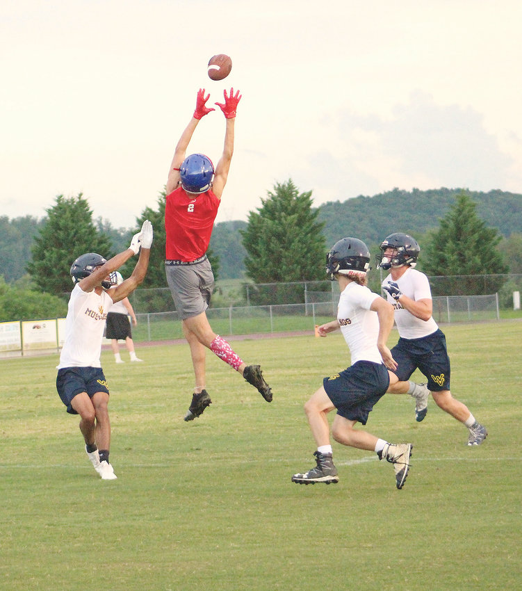 CLEVELAND BLUE RAIDER Robert Flowers goes up to make a catch near the end zone during a 7-on-7 scrimmage against Walker Valley Thursday, at Walker Valley.