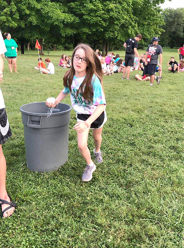 CALLI ELLIS runs for the green team during Water Olympics.