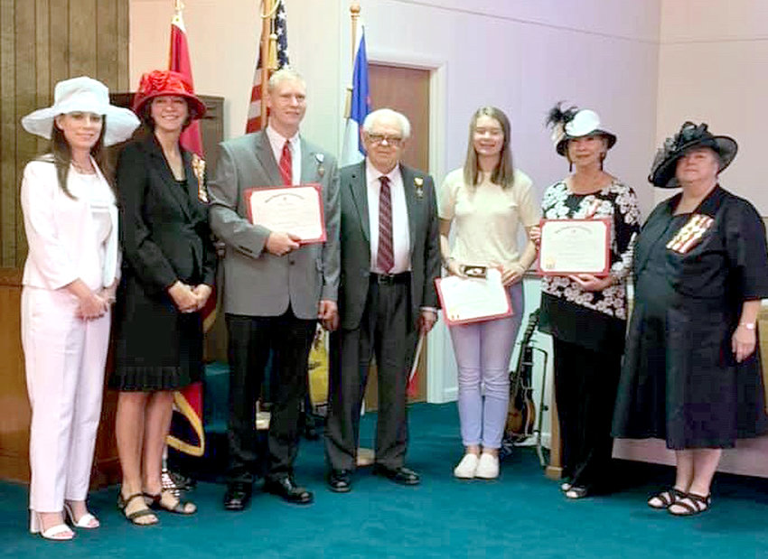From left are  Amy Kibble (serving as page), UDC President Linda Ballew, Dustin Robert Hunt, Daniel Boone Hall Jr., Madison Sherlin on behalf of Robert Anthony Sherlin, Janice Rogers Duff on behalf of Frank Houston Rogers,  and UDC Recorder of Military Service Marilyn Kinne.